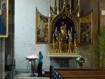 You-know-who lighting a candle for her mother, Anne Lamy, who loved the Madonna. Rotweil, Germany
