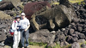 Charlene and Hoyt on Easter Island with toppled Moai statue