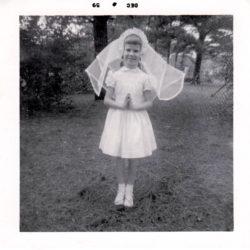 54360d584 Charlene on her First Communion day 1959. Salisbury, MD. Family backyard.